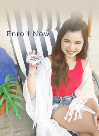 Girl holding a Classic Mabuhay Miles Membership Card