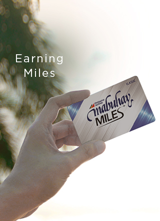 Image of a hand holding a Mabuhay Miles Travel Card