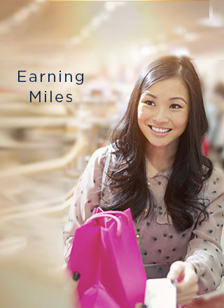 An image of a girl shopping and presenting her Mabuhay Miles membership card