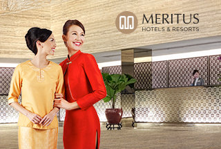 Meritus Hotels and Resorts models and logo with hotel lobby as background